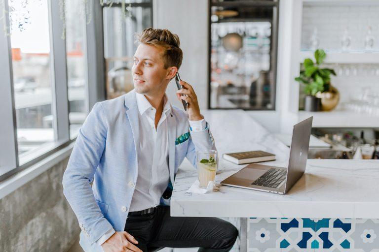 business owner making phone call at bar