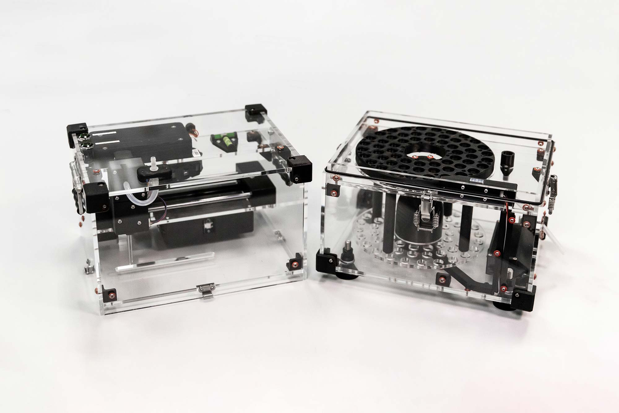 Photo of Syp autosampler device  disassembled into two halves on a benchtop in the lab.