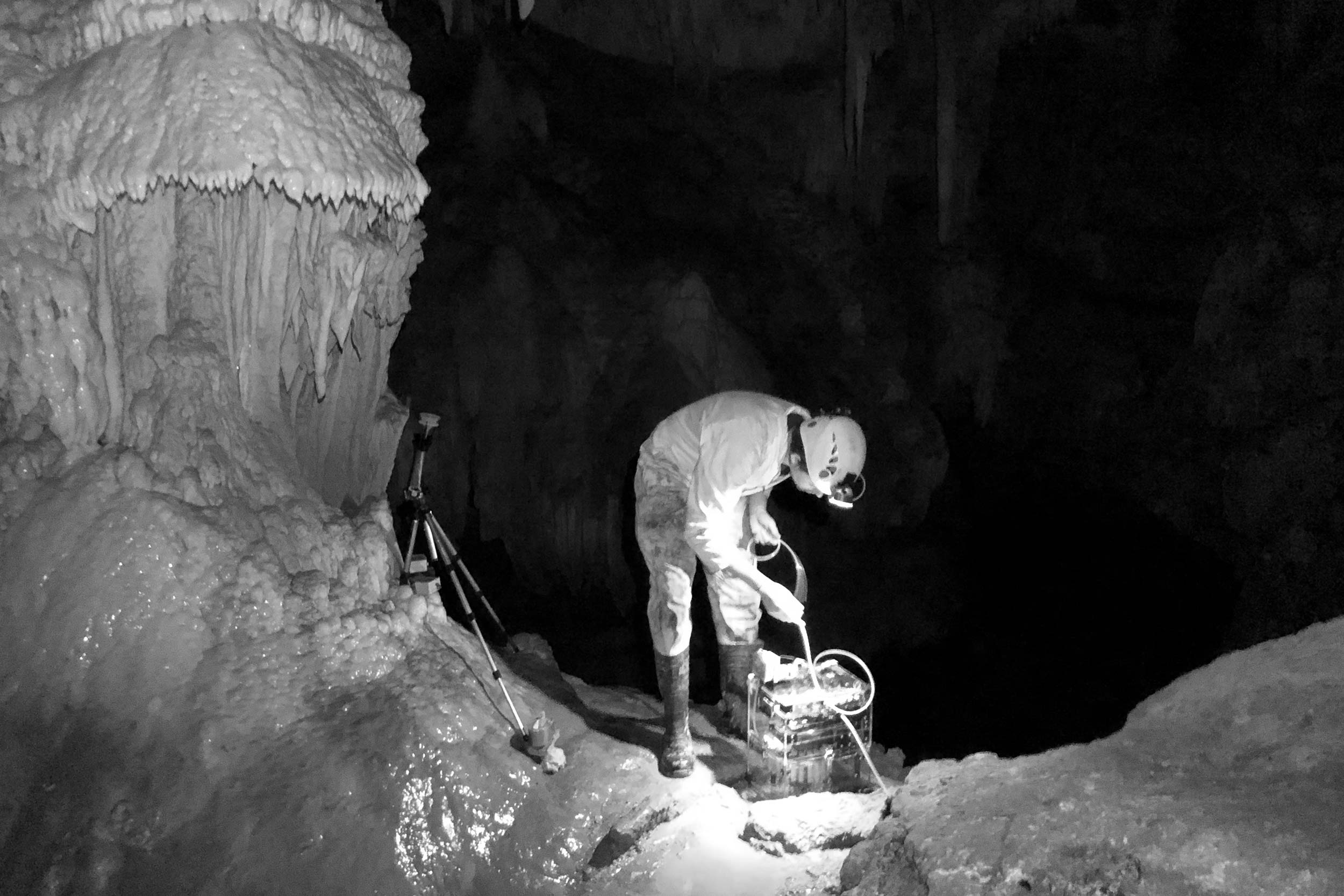 Syp autosampler device being installed by in cave by field scientist.