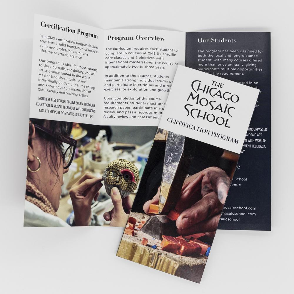 Image of tri fold brochure for Chicago Mosaic School, featuring an image of a hand holding a chisel.
