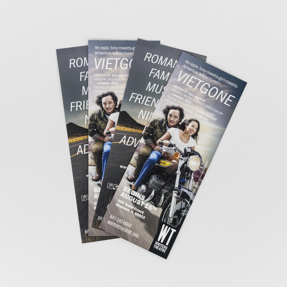 """Image of a bookmark for a theatre production at Writers Theatre called """"Vietgone"""" with a photo of a man and women on a motorcycle."""