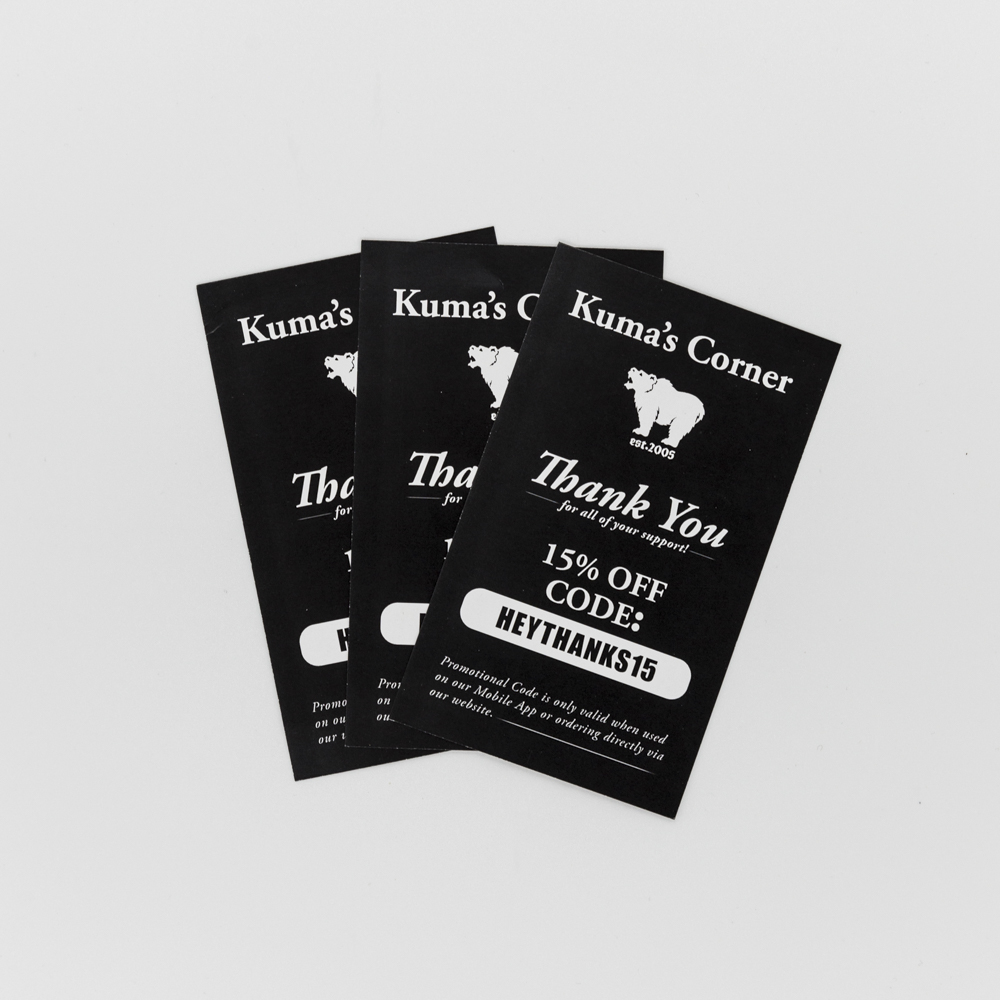 Image of check stuffer for Kuma's Corner with a promo code.