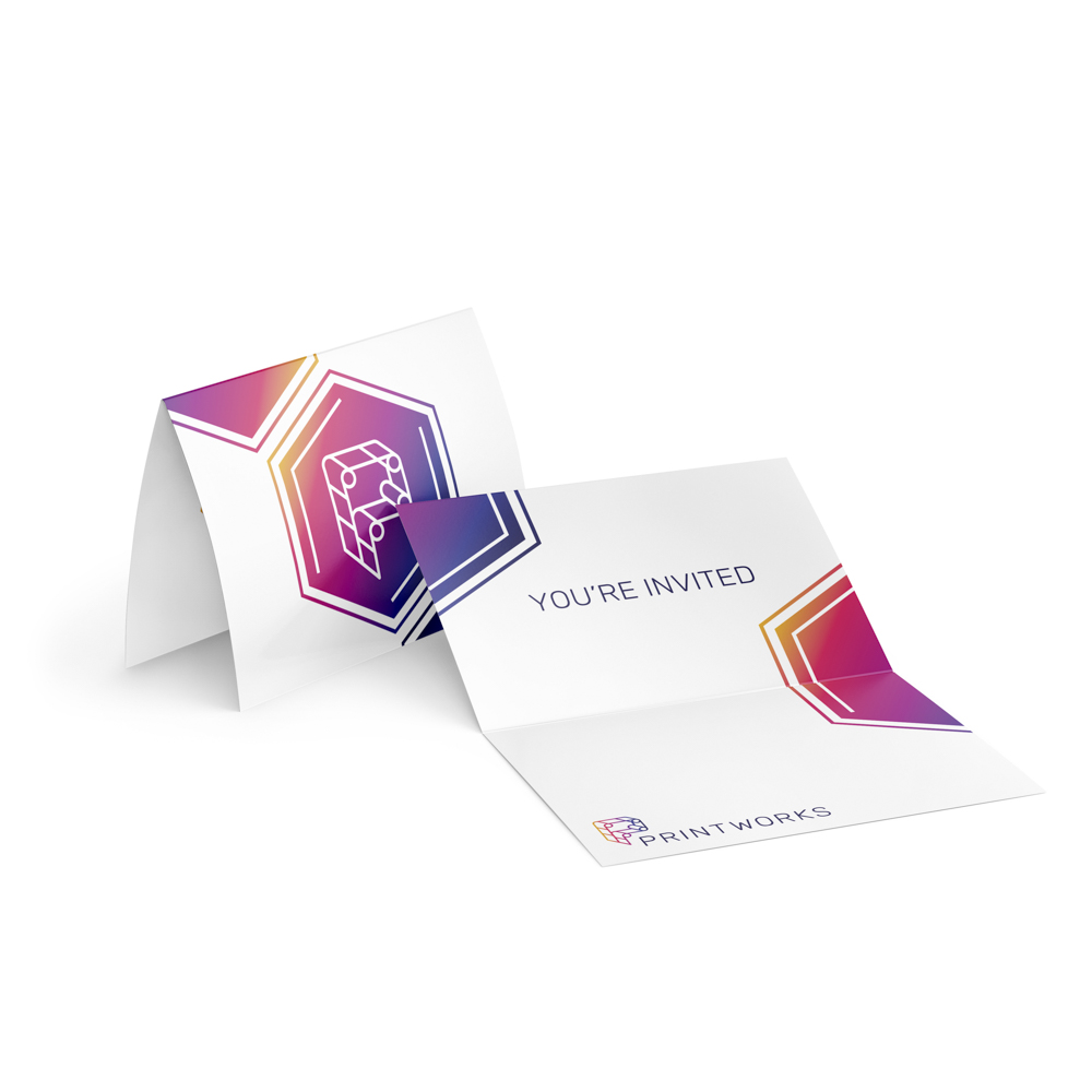 """Image of a folded invitation card, with Printworks logo on the front and """"you're invited"""" text inside."""