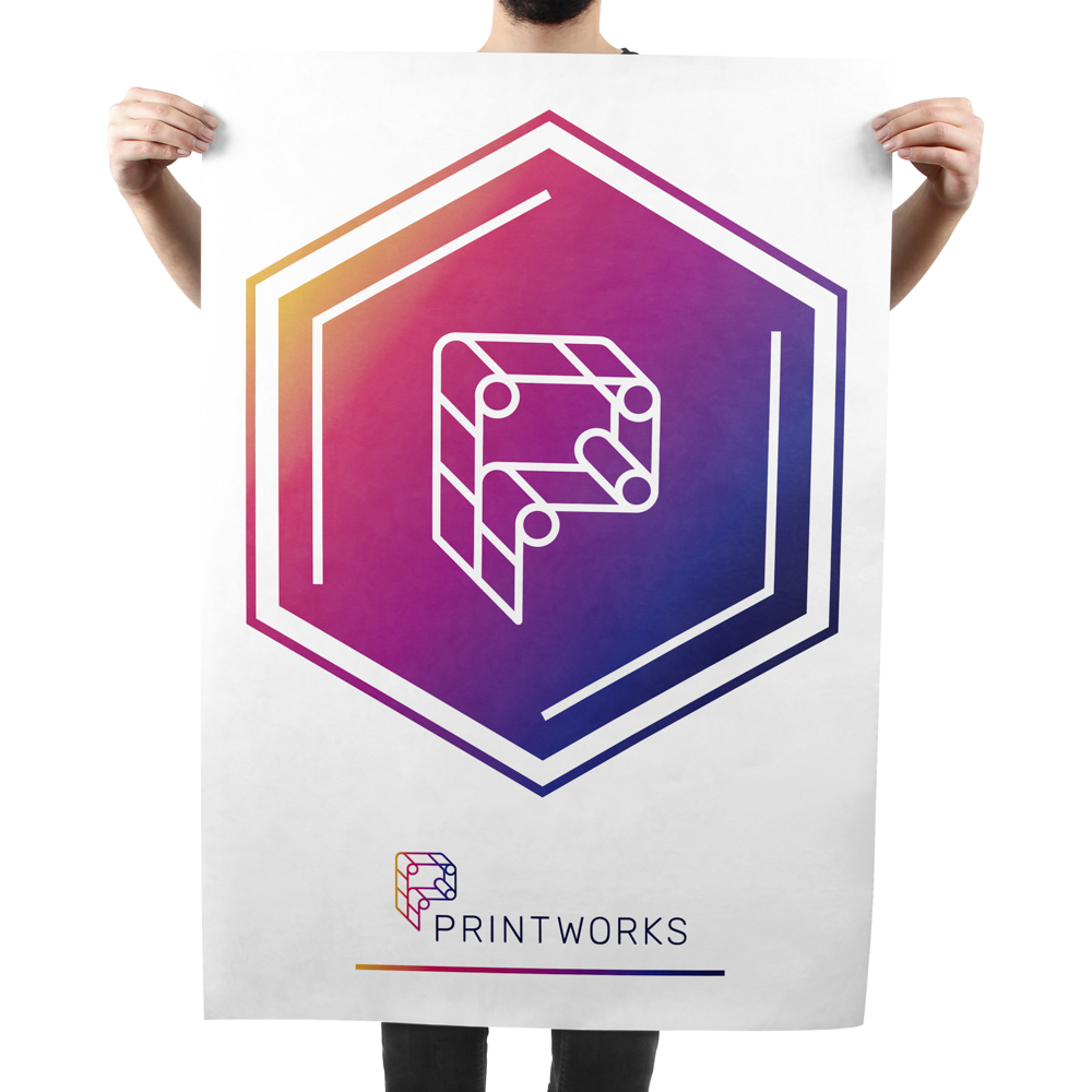 Image of a man holding up a large poster featuring Printworks branding