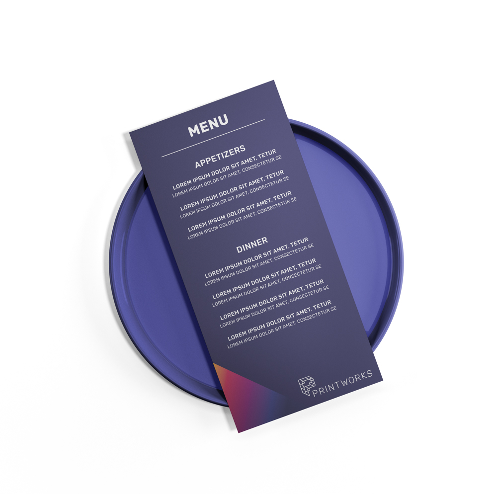 Image of a full color custom menu sitting on top of a blue plate
