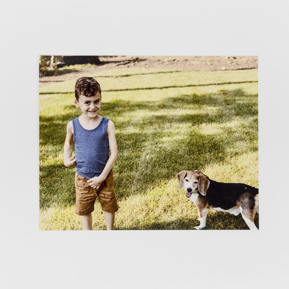 Photo of a child with his dog.