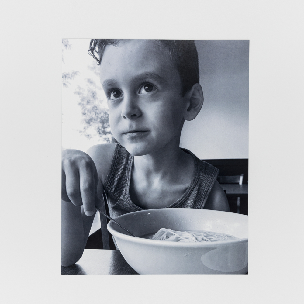 Photo of a child eating a bowl of cereal.
