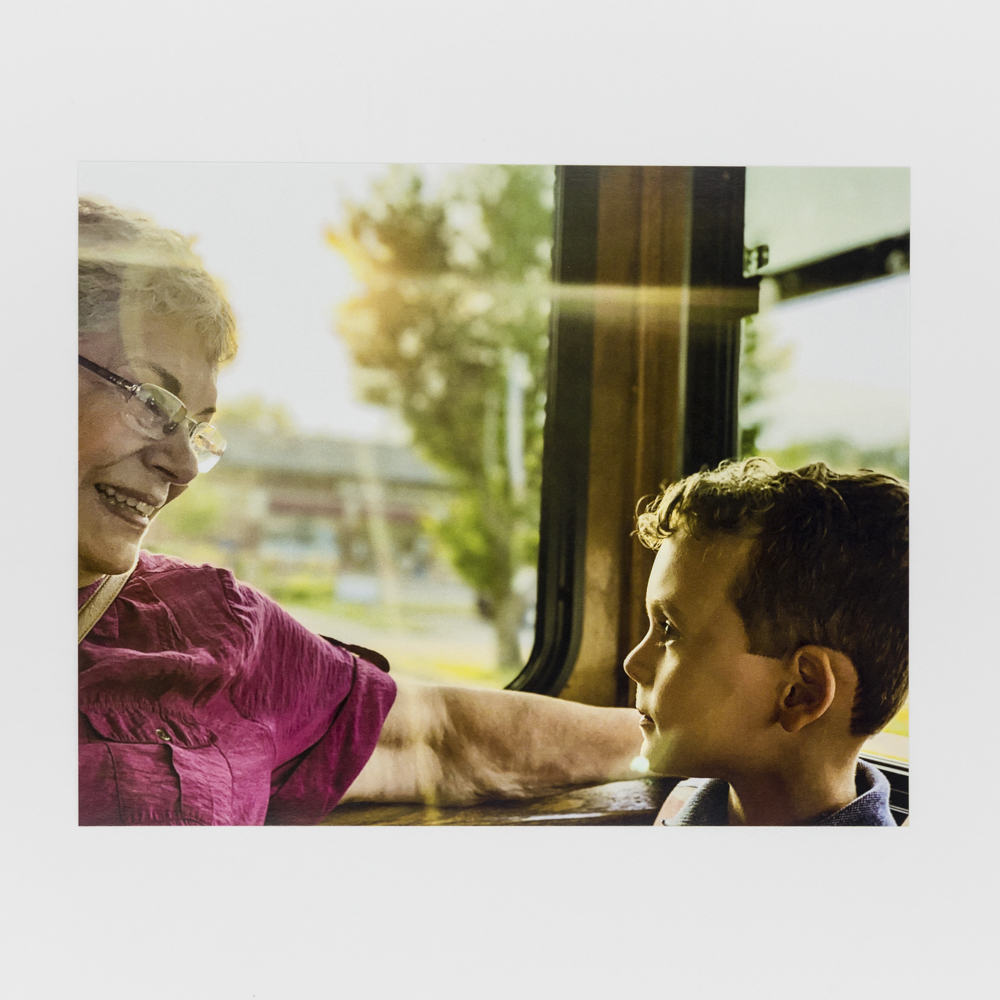 Photo of a child with his grandmother.