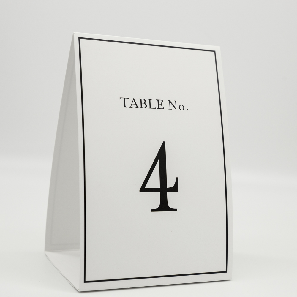 """Place card with the text """"Table no. 4""""."""