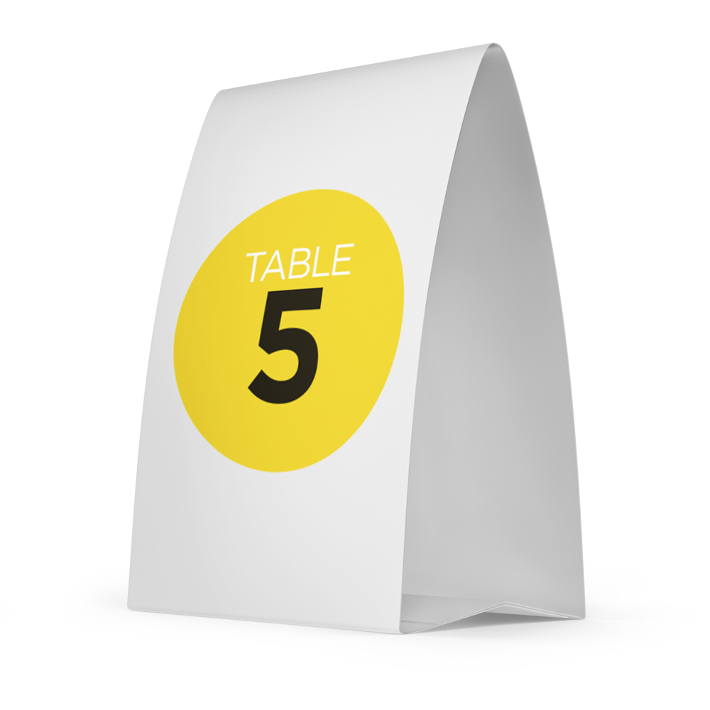 """Place card with the text """"Table 5"""" inside of a yellow circle."""