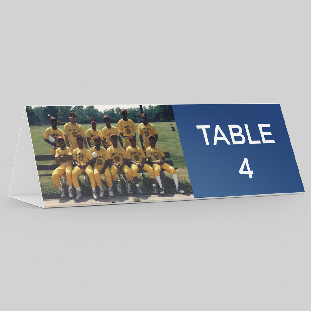 """Place card with photo of a softball team with the text """"Table 4""""."""