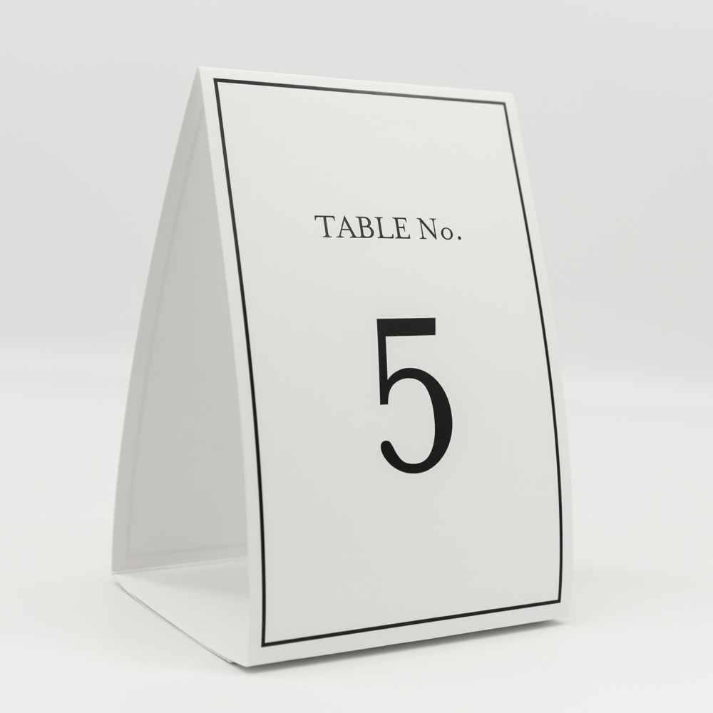 """Place card with the text """"Table no. 5""""."""