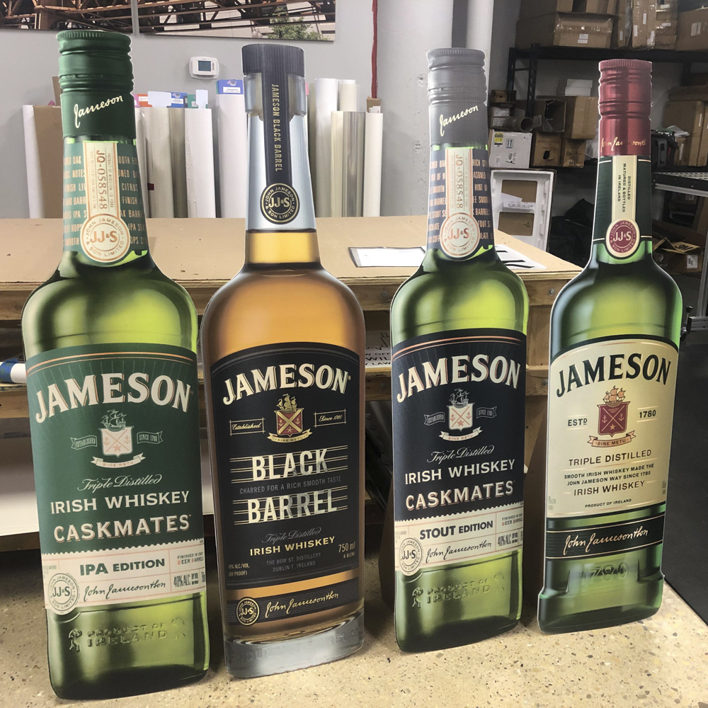 Retail signage featuring Jameson whiskey cut out bottles.