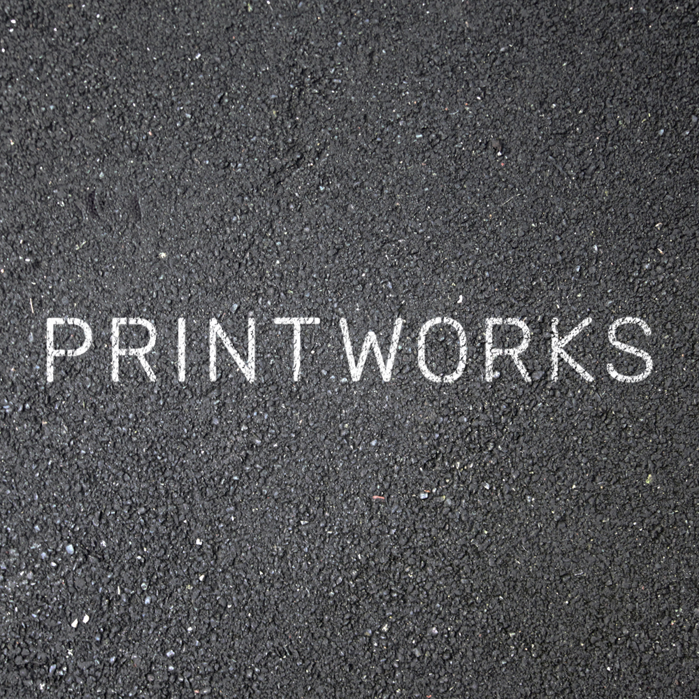 "Image of asphalt with ""Printworks"" stenciled onto it"