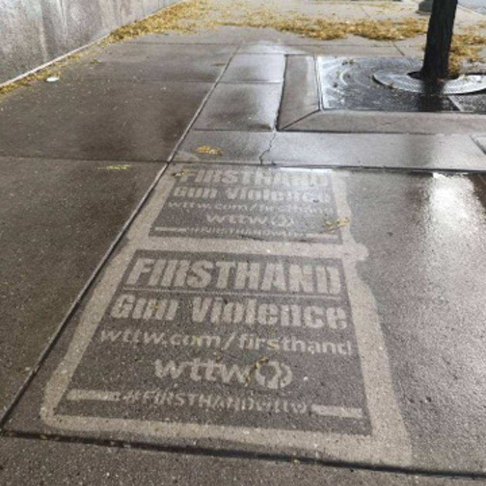Two WTTW firsthand gun violence reverse graffiti stencilings on sidewalk.