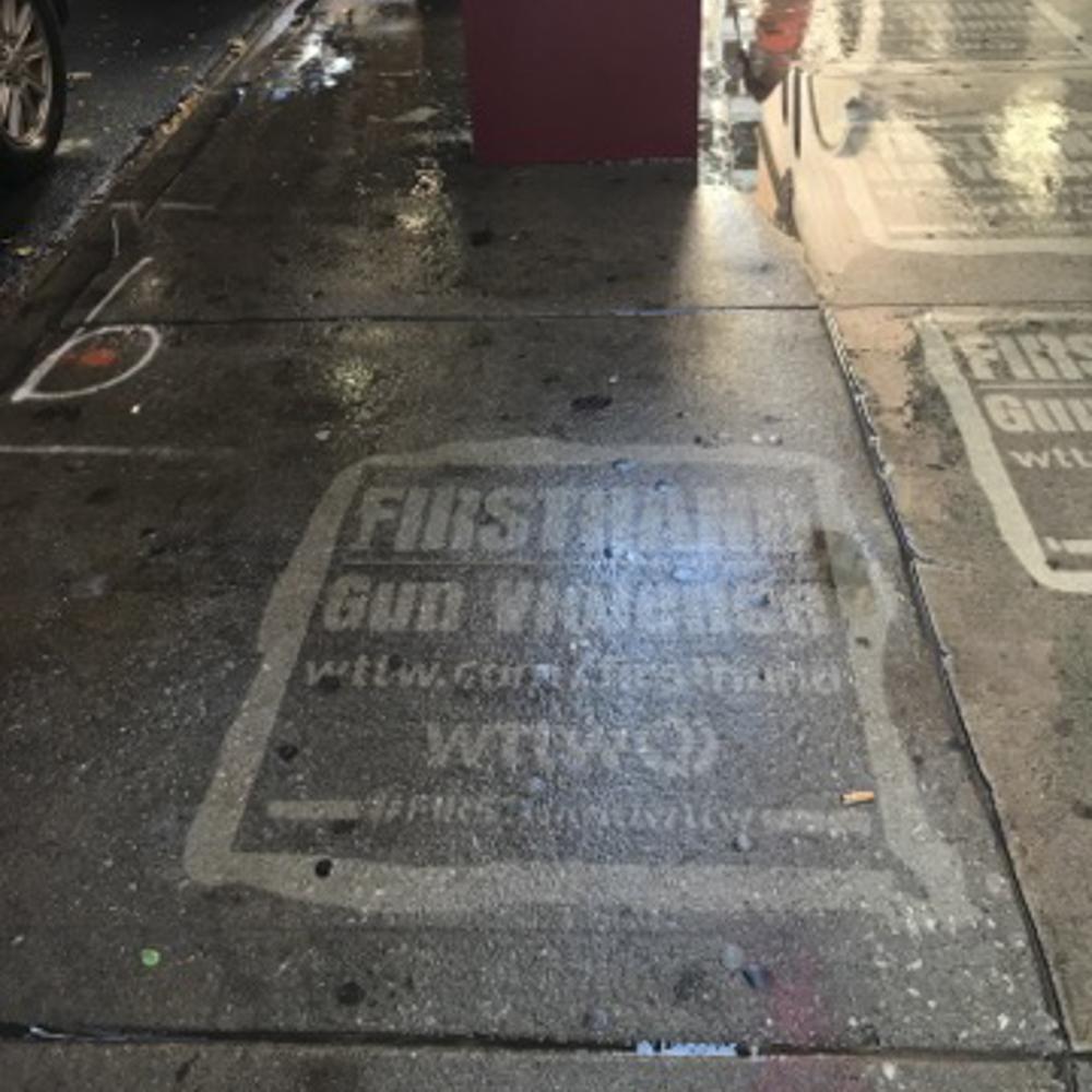 WTTW Firsthand gun violence reverse graffiti stenciling on sidewalk.