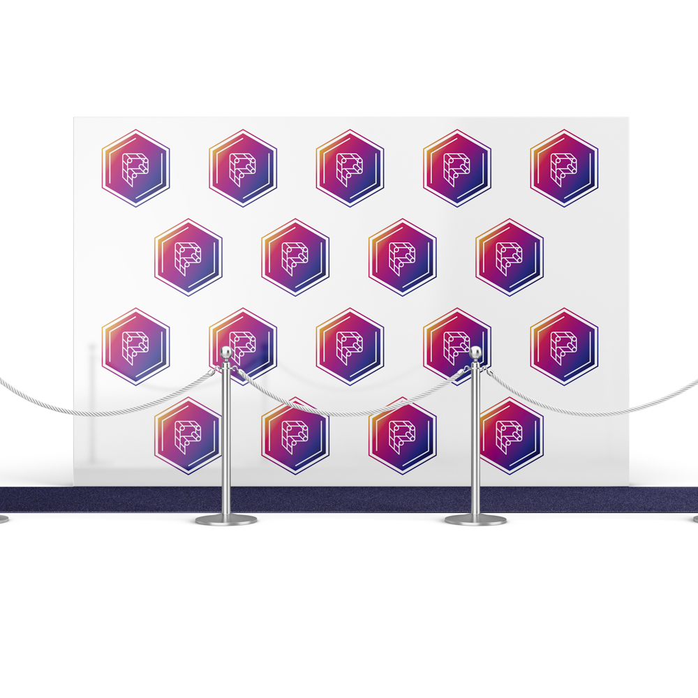 Image of a backdrop with the Printworks logo printed on in a repeated pattern