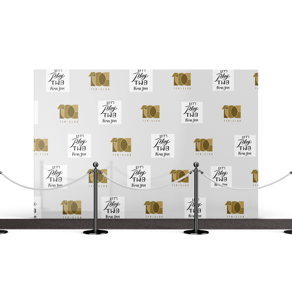 """Step and Repeat backdrop with """"lets play two"""" text."""
