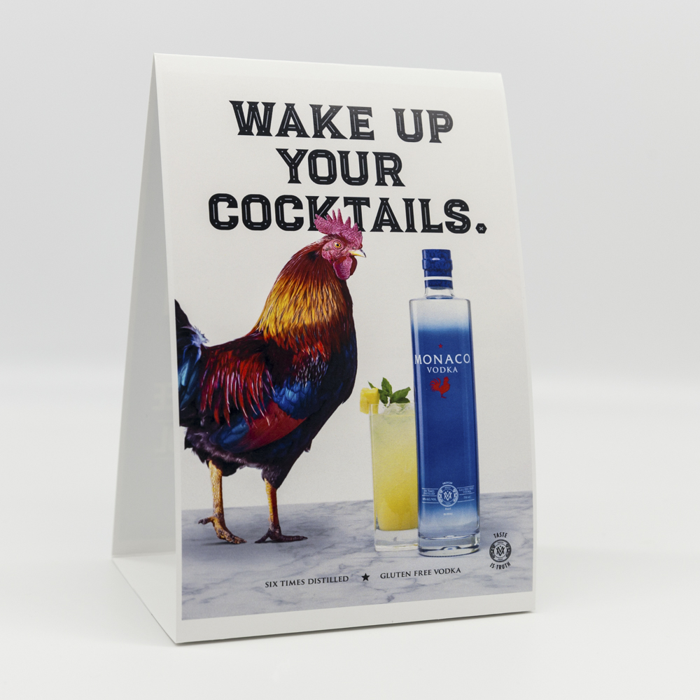 Table tent with image of a rooster and bottle of vodka.