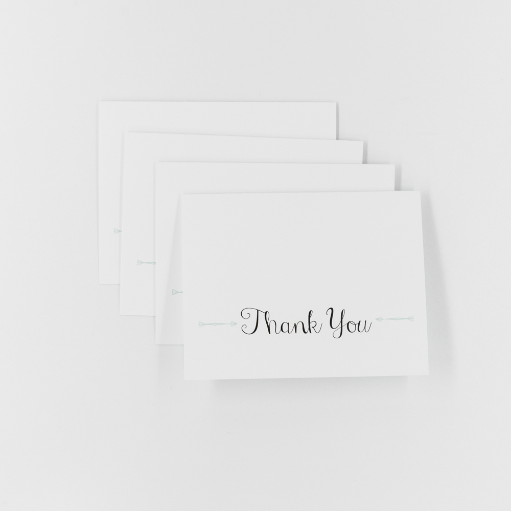 White thank you card with black script text.