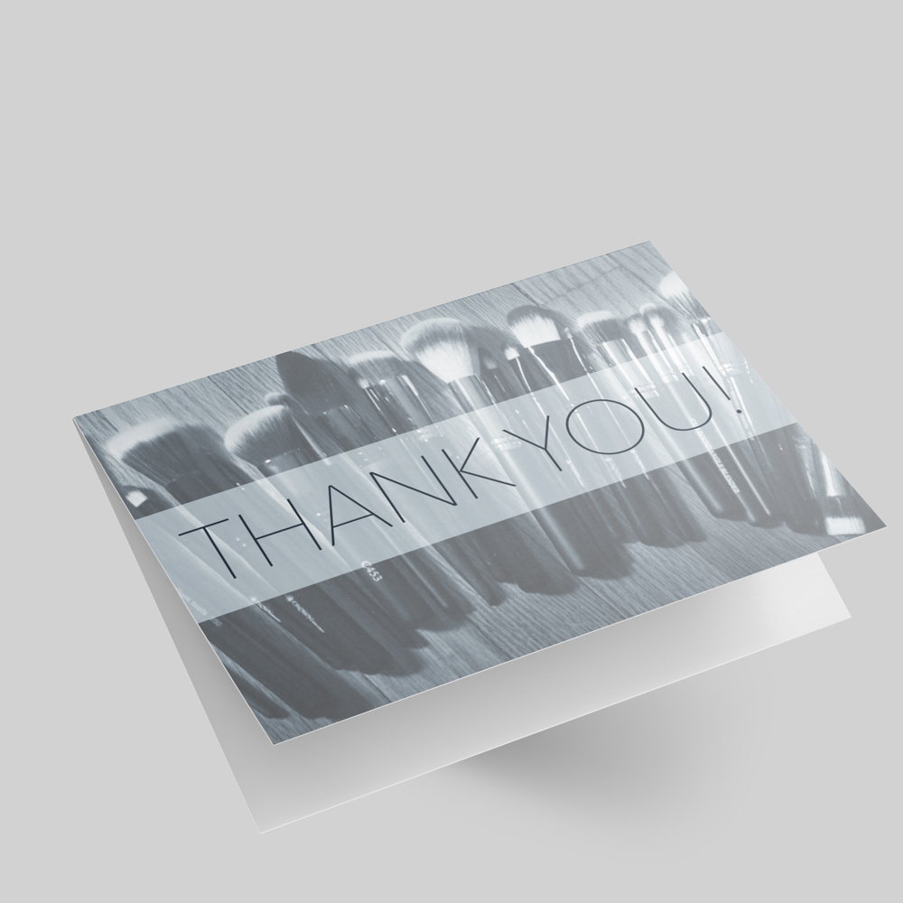 Thank you greeting card with a photo of makeup brushes.
