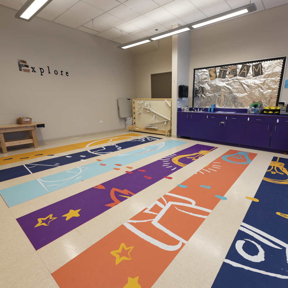 Photo of colorful floor graphics featuring footprints.