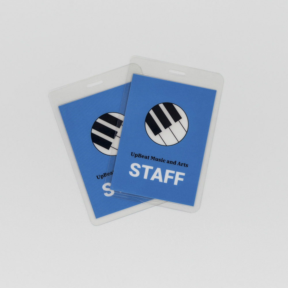 Blue event staff badge with an illustration of a keyboard.