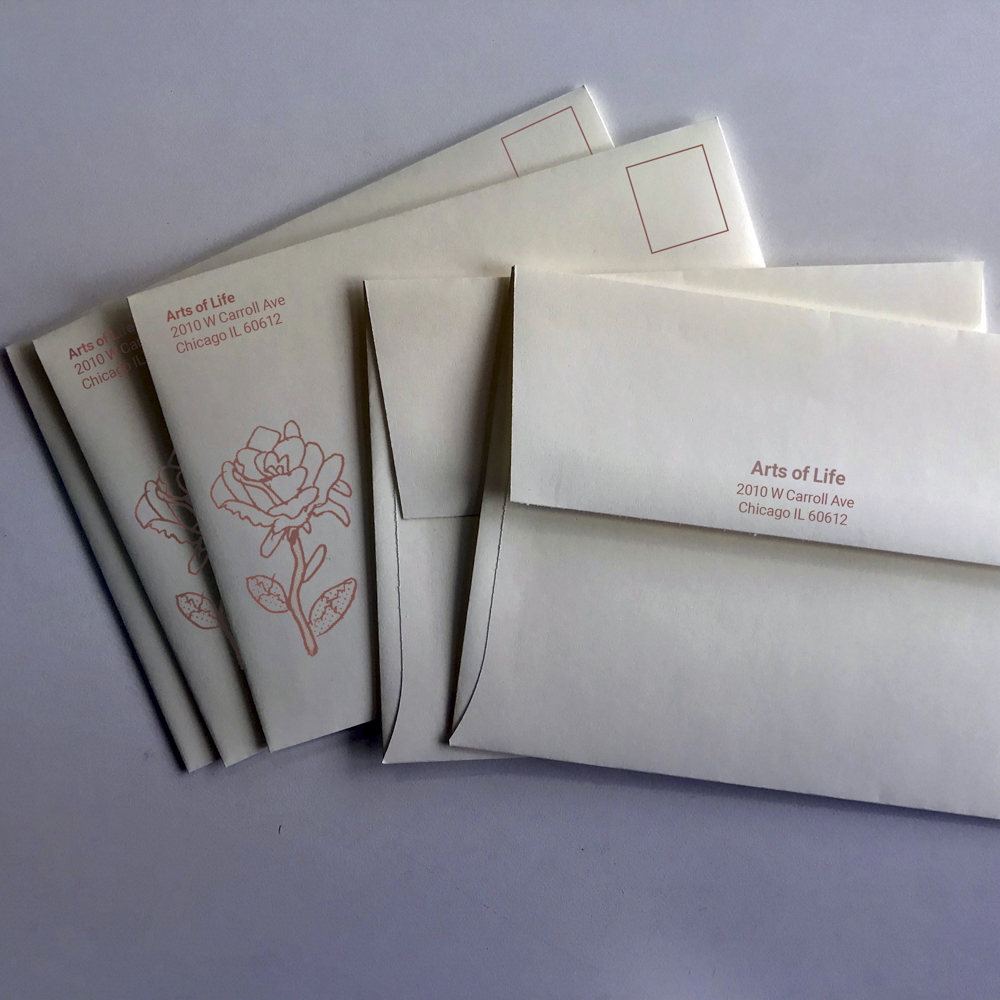 Image of remittance envelopes for Arts of Life featuring an illustration of a rose.