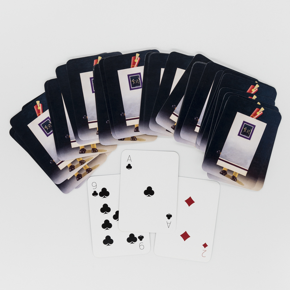 Photo of deck of custom printed playing cards featuring artwork of a tin man.