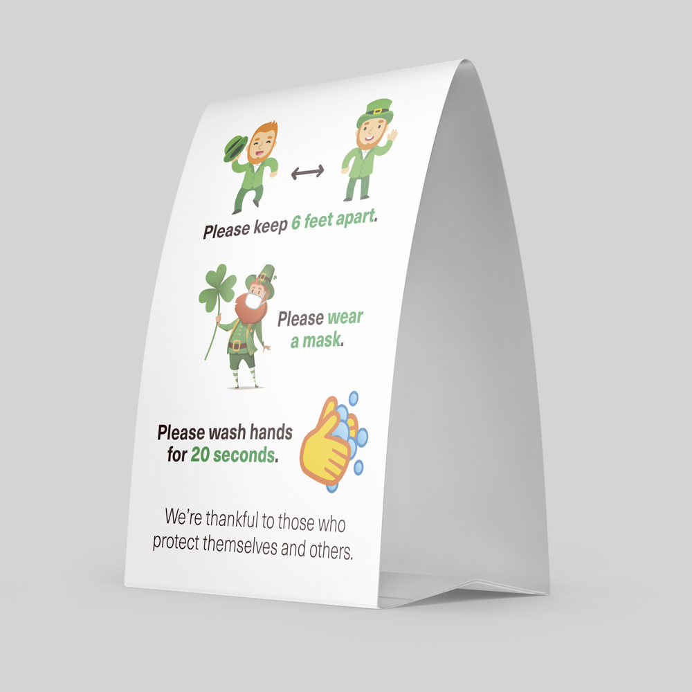 Image of coronavirus table tent signage encouraging hand washing and social distancing.