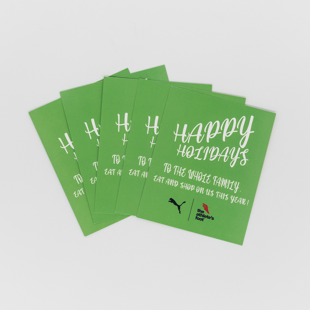"""Image of a green holiday card with text """"Happy Holidays to the Whole Family""""."""