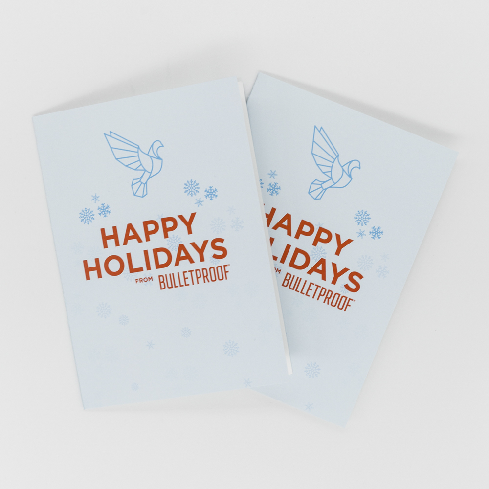 Image of custom printed holiday card with illustrations of a dove and snowflakes.