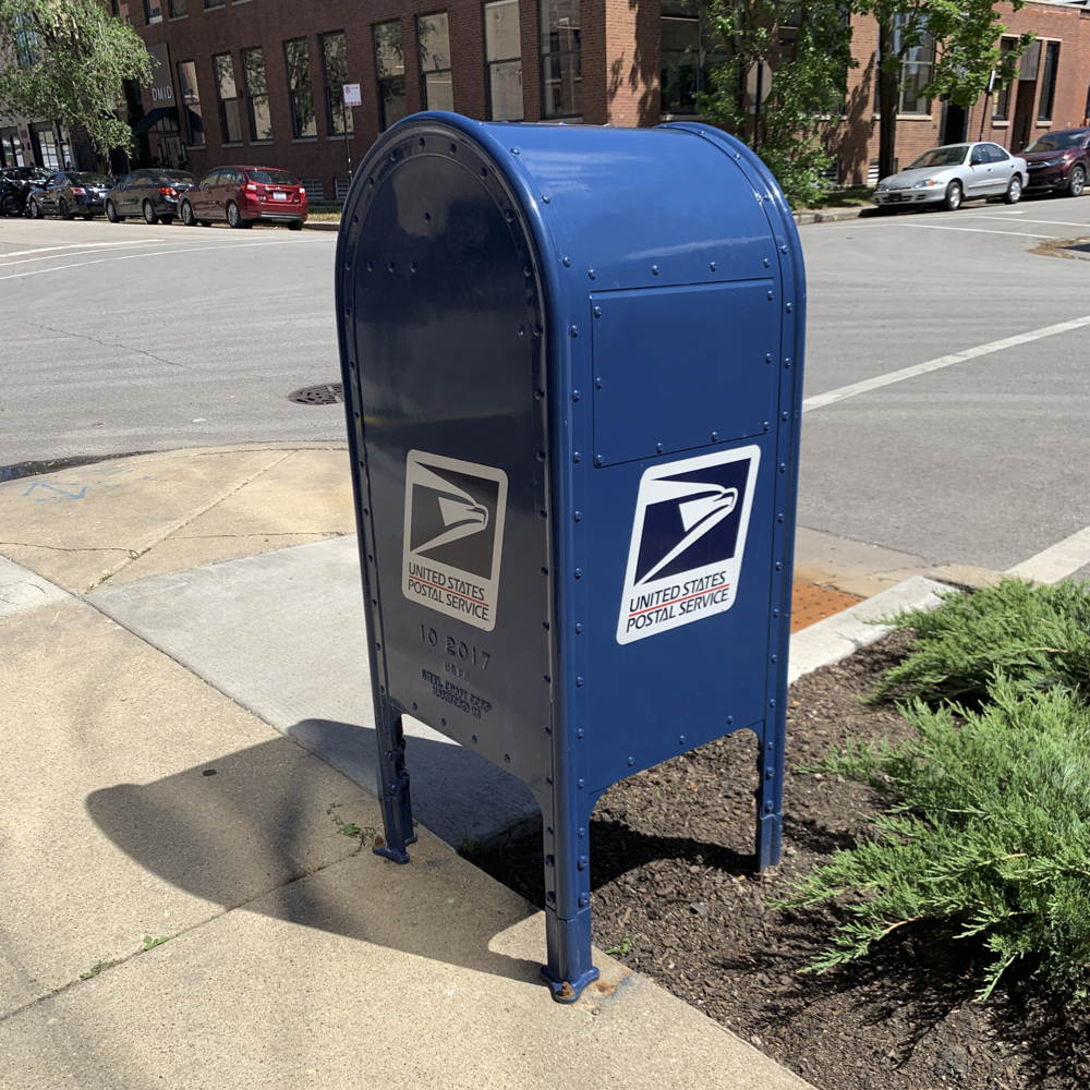 Photo of United States Post Office blue mailbox.