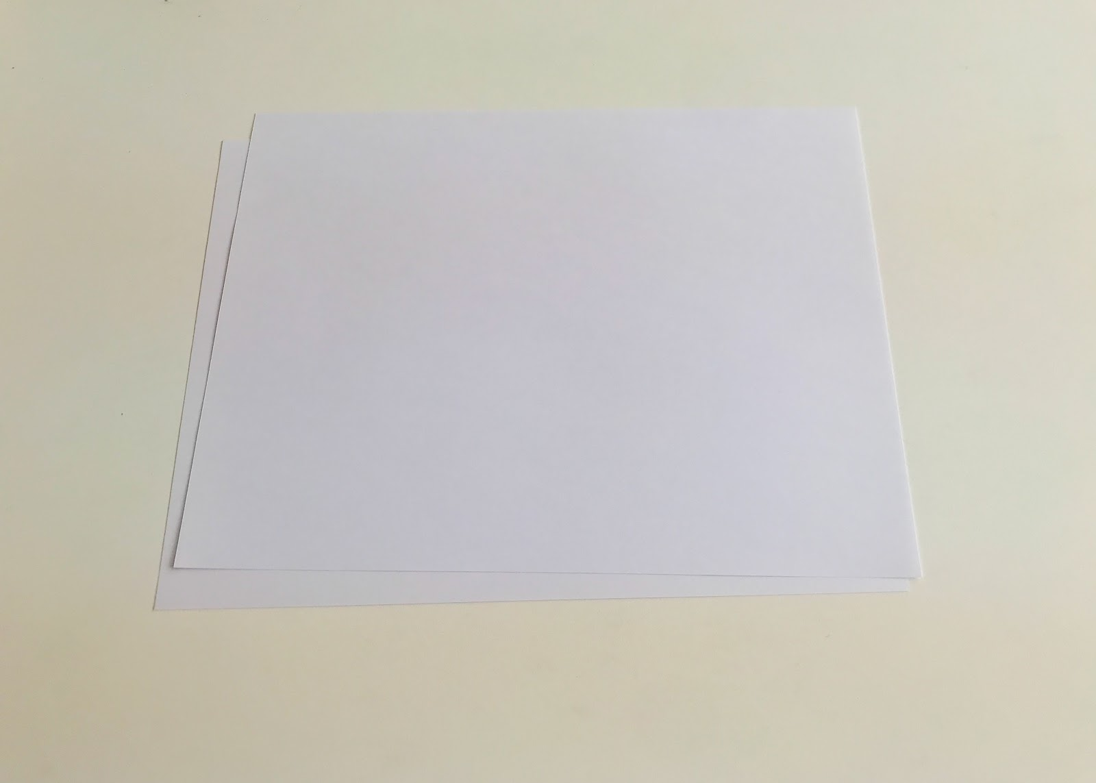 Image of two flat pieces of paper.