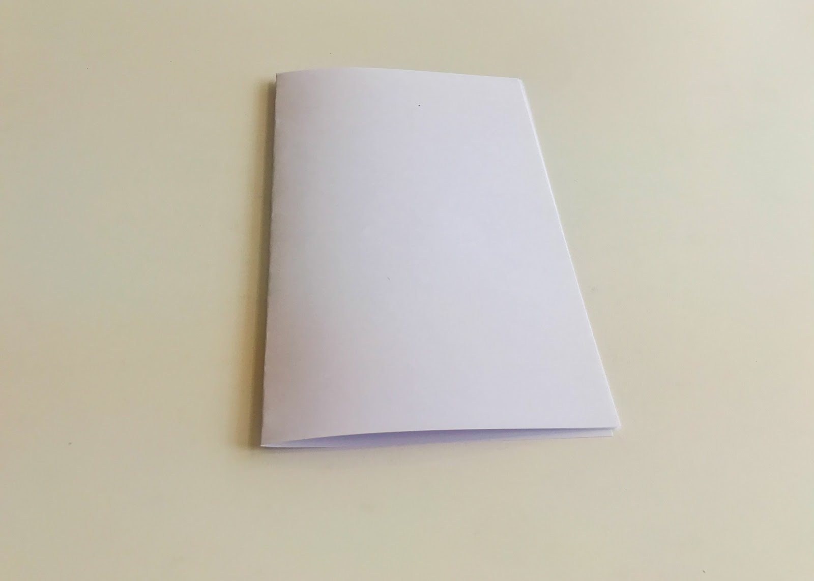 Image of two pieces of paper folded in half.