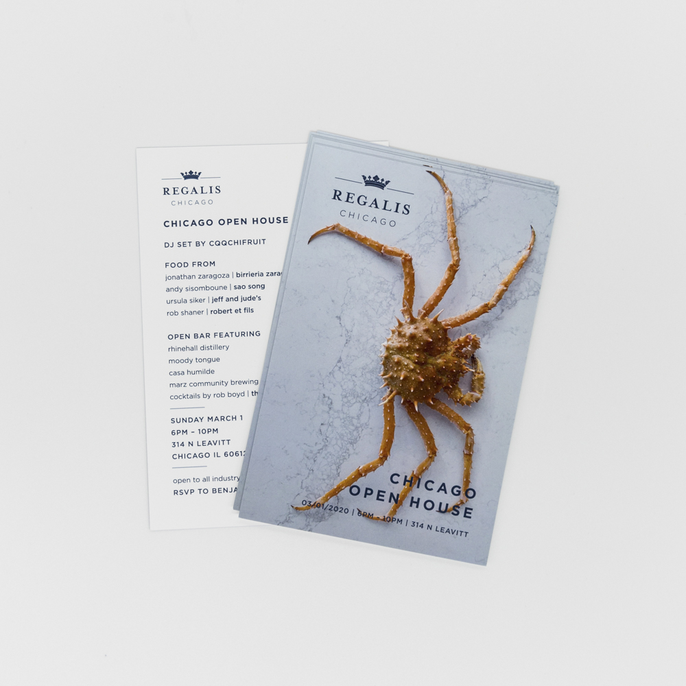 Invitation featuring a photo of a crab.