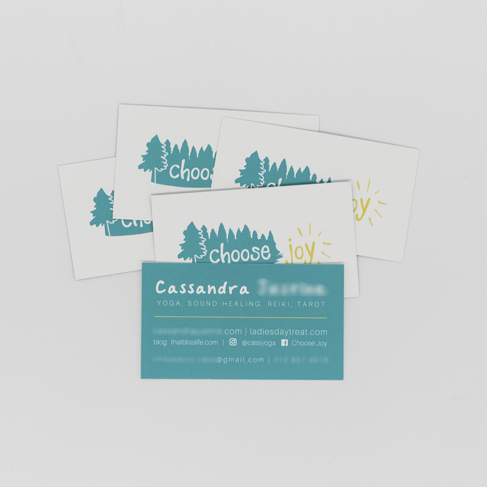 Image of business card for Choose Joy featuring an illustration of pine trees.