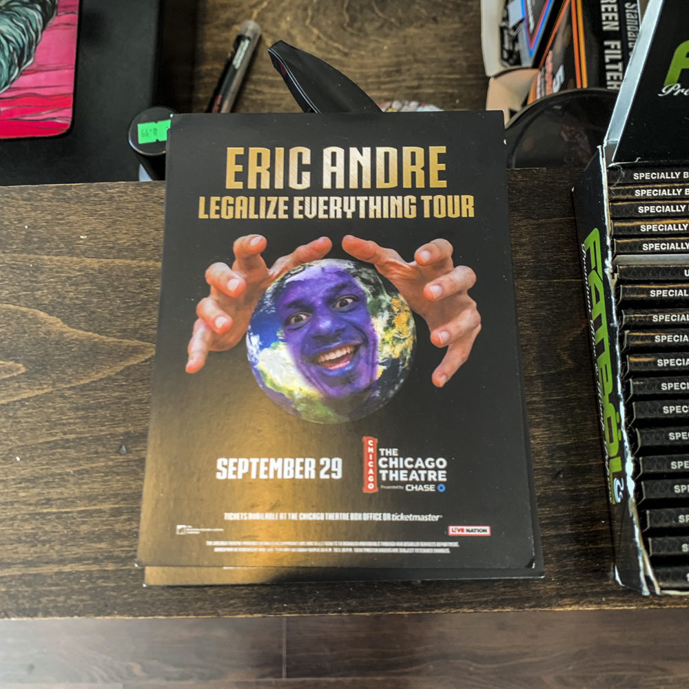 Image of an Eric Andre postcards on a table at retail location.