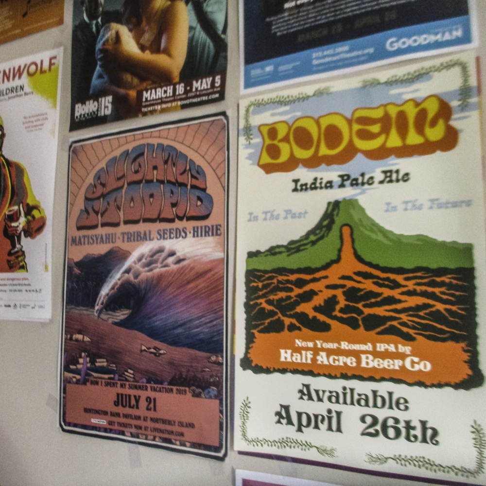 Image of 4 posters on the wall of a retail location.