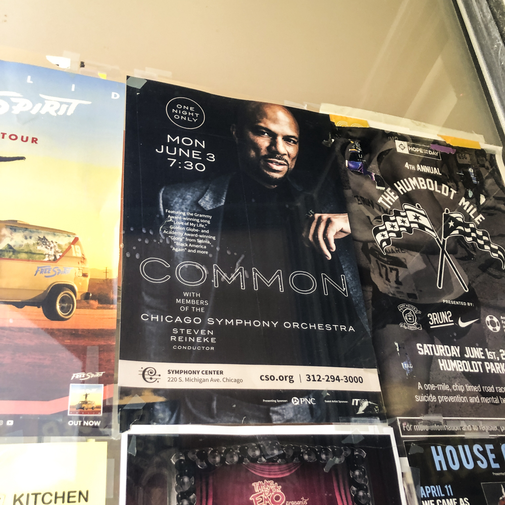 Image of poster on the wall of a business for an orchestra performance.