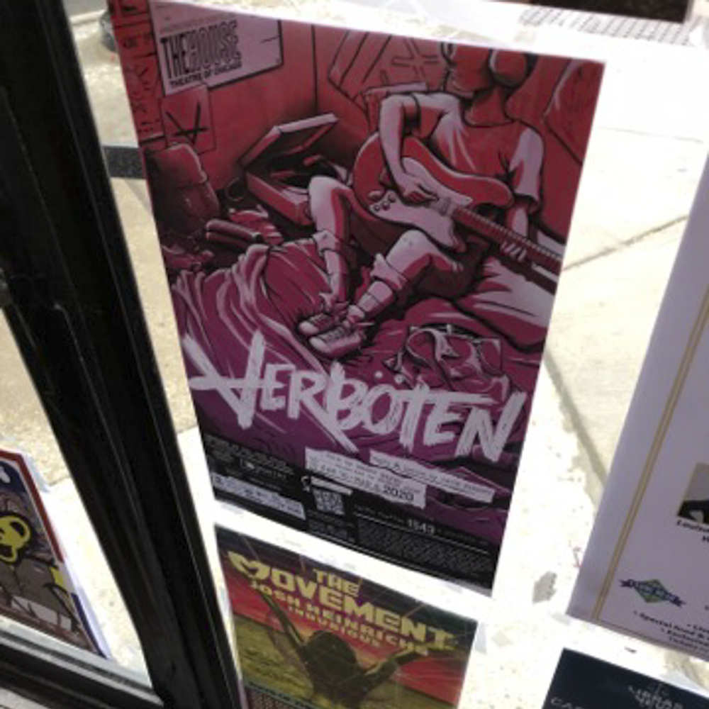 Image of a poster in a business window for a theatre performance.