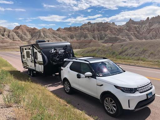 Micah's SUV pulling a camper