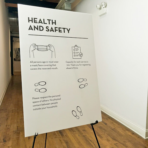 Indoor sign displaying health and safety protocol