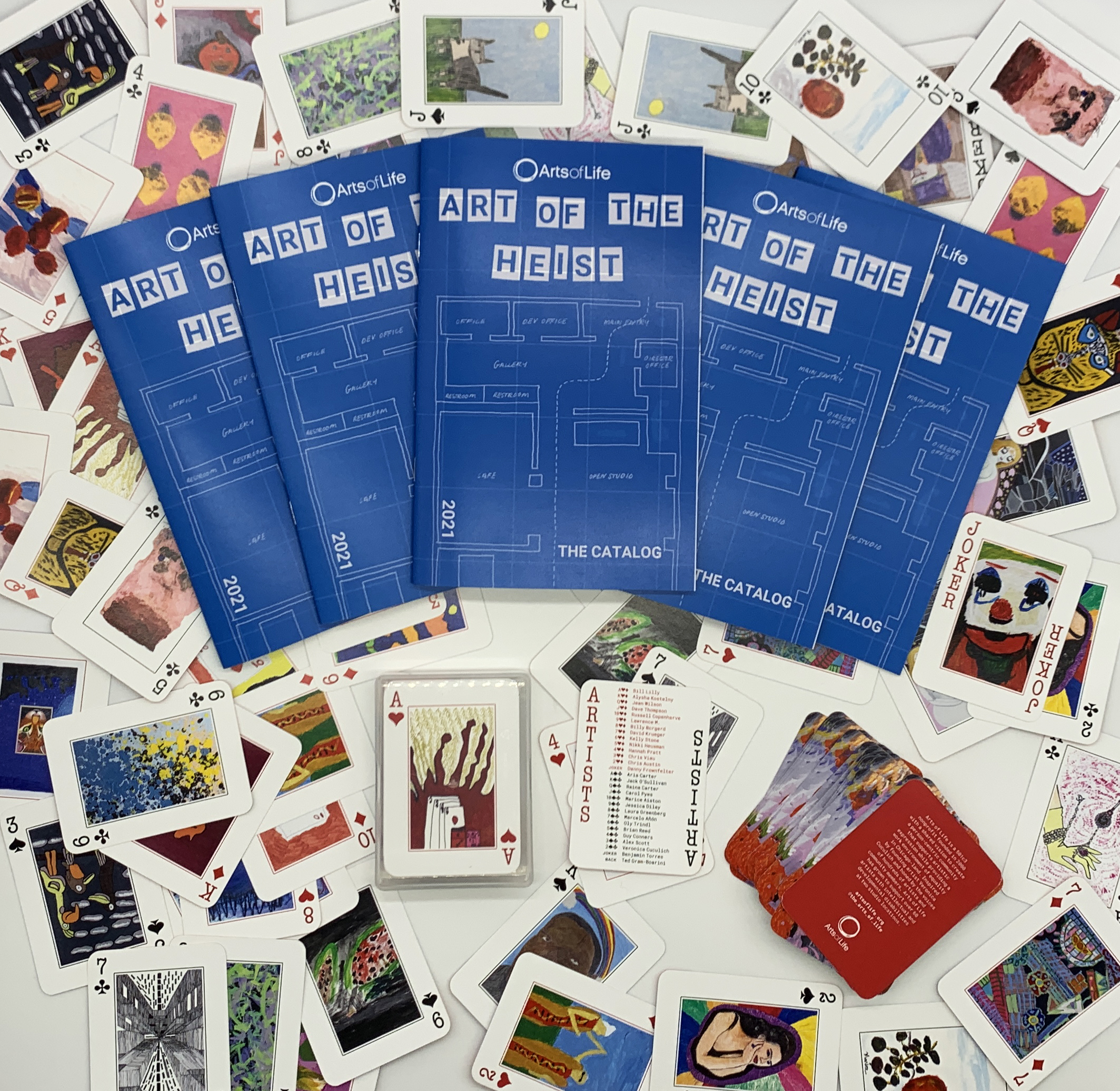 Image of Arts of Life playing card decks and auction catalogs for Art of the Heist.