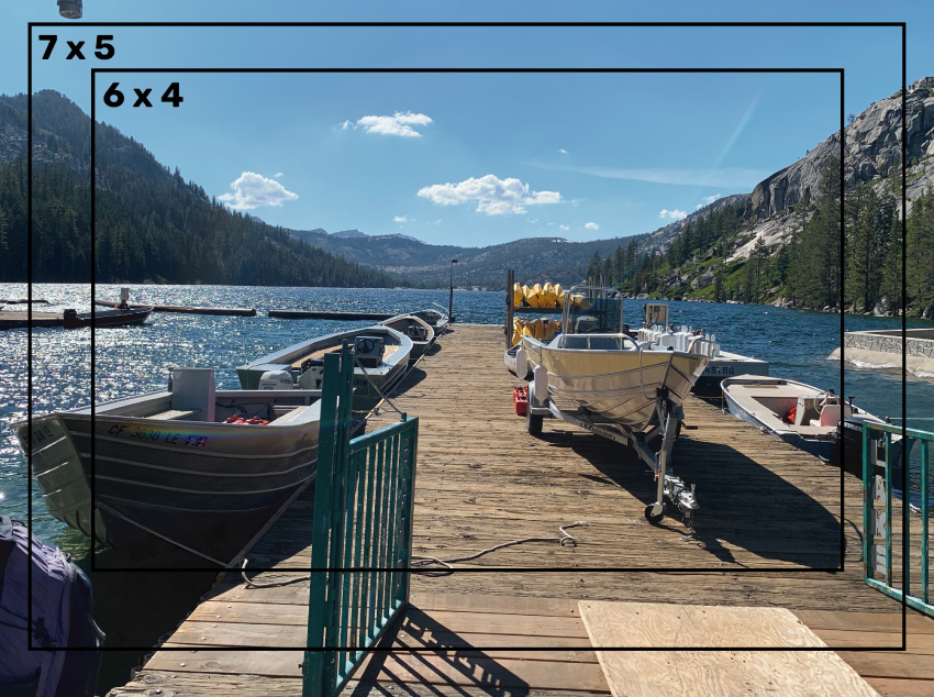 Image of a dock at Echo Lake, with several boats. Black boxes indicate possible frame sizes for a printed photo.