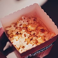 A picture of popcorn representing the concession stand package.