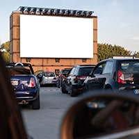 A picture of cars at a drive in reflecting the drive in sound option.
