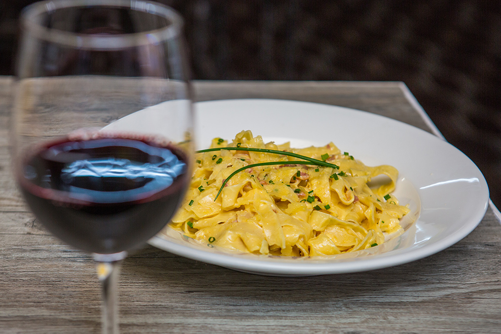 Pasta accompanied by a red wine