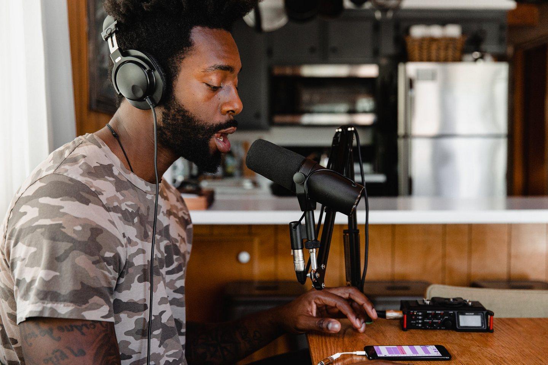 Black rastafarian recording song on phone