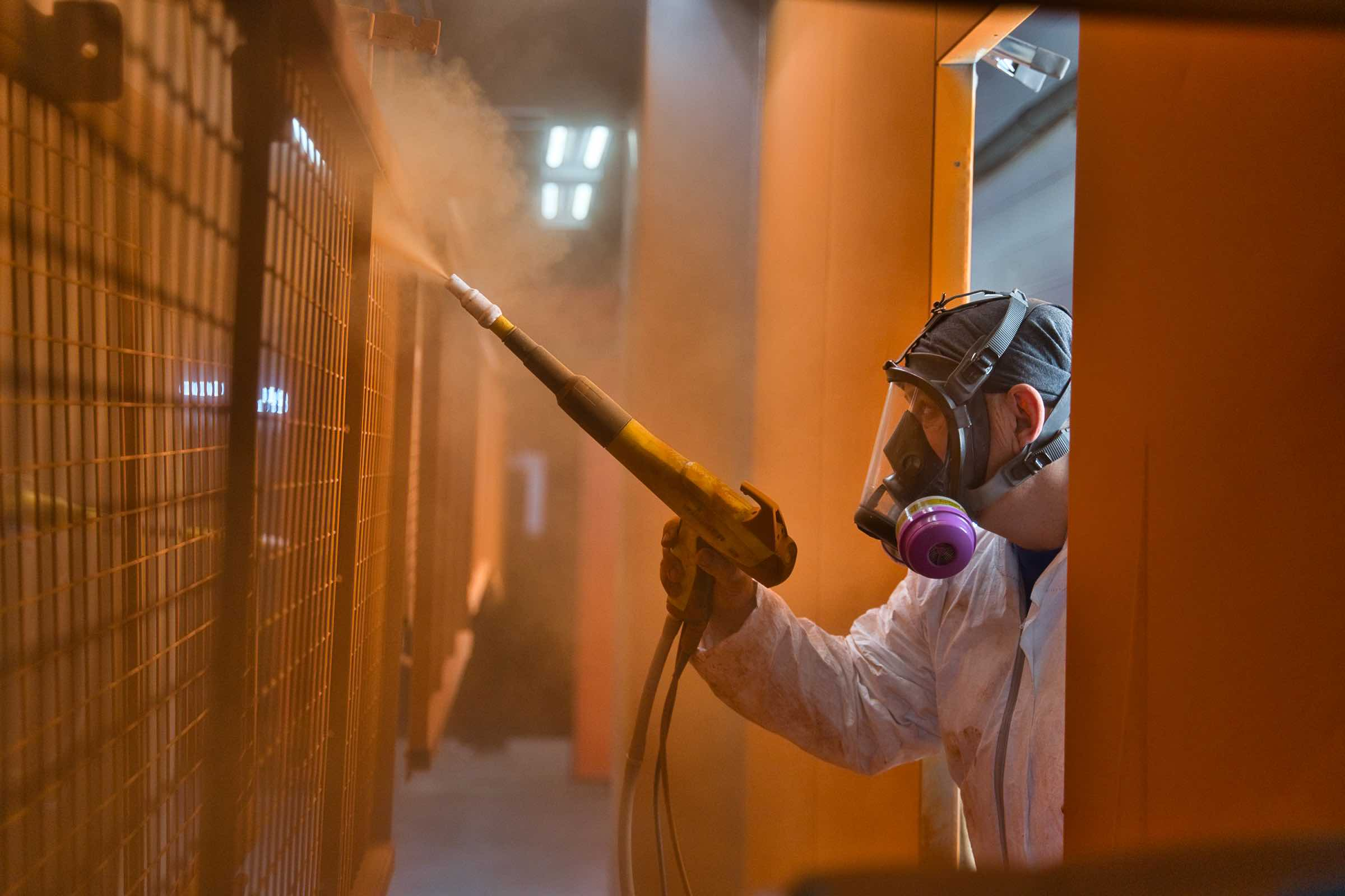 Painter applying powder coating
